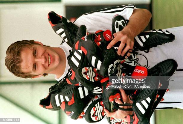 Manchester United and England Footballer David Beckham after signing a new deal with Adidas boots at their Stockport headquarters today PA photo by...