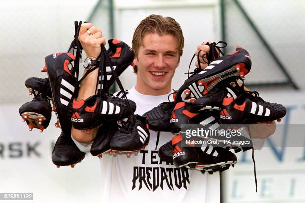 Manchester United and England Footballer David Beckham after signing a new deal with Adidas boots at their Stockport headquarters