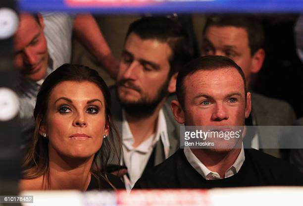 Manchester United and England footballer Wayne Rooney and wife Coleen look on from ringside at Manchester Arena on September 24 2016 in Manchester...
