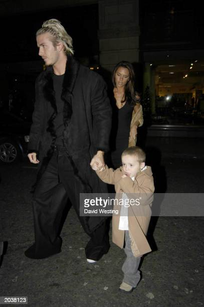 Manchester United and England soccer star David Beckham with pop star wife Victoria and son Brooklyn attending performance of Chitty Chitty Bang Bang...