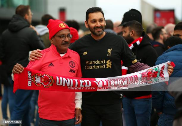 Manchester United and Liverpool fan pose for a picture during the Premier League match between Manchester United and Liverpool FC at Old Trafford on...