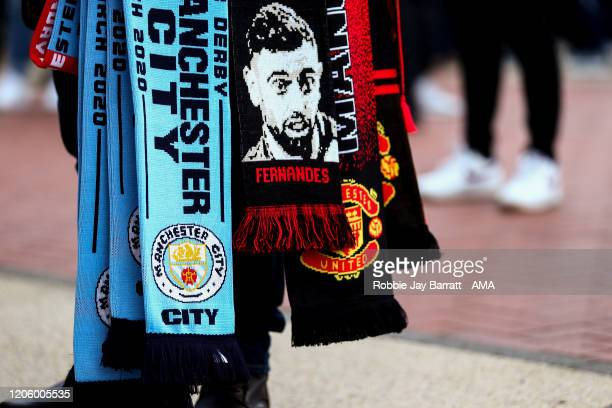 Manchester United and Manchester City half and half scarf prior to the Premier League match between Liverpool FC and AFC Bournemouth at Anfield on...