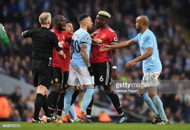 Manchester United and Manchester City players clash during the Premier League match between Manchester City and Manchester United at Etihad Stadium...