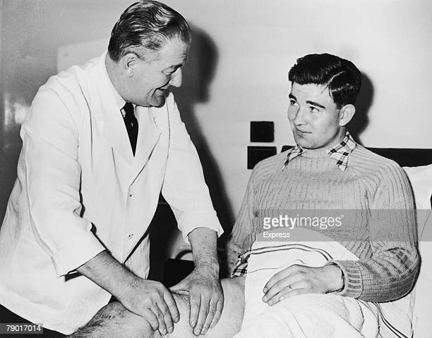Manchester United and Northern Ireland footballer Jackie Blanchflower receiving medical treatment from the club's physiotherapist 1958 Blanchflower...