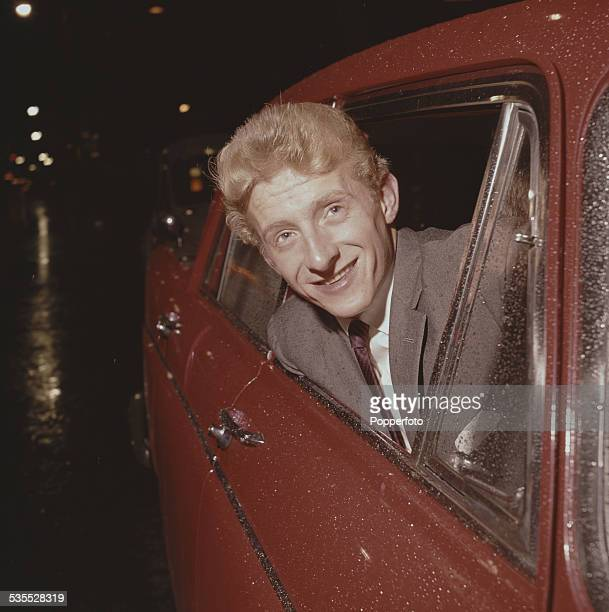 Manchester United and Scotland footballer Denis Law pictured leaning out of the window of a car in Manchester in 1962