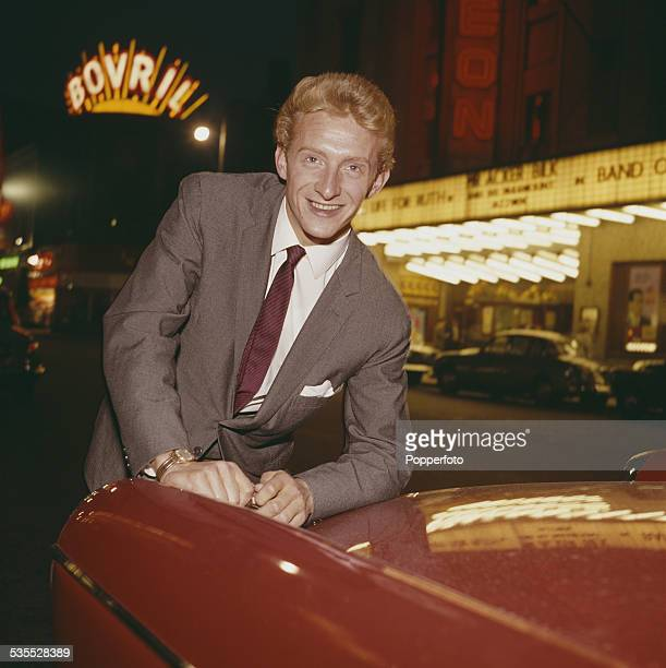 Manchester United and Scotland footballer Denis Law posed outside the Odeon Cinema in Oxford Street Manchester in 1962 A large Bovril neon sign is...