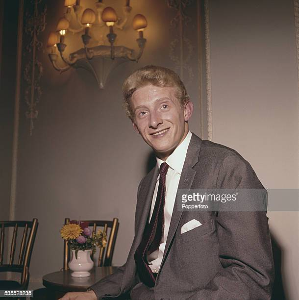 Manchester United and Scotland footballer Denis Law posed wearing a grey suit and red striped tie in 1962
