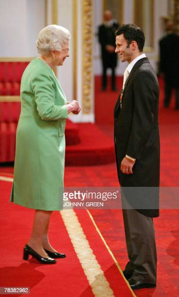 Manchester United and Wales footballer Ryan Giggs is made an Order of the British Empire for services to football by Queen Elizabeth II inside the...