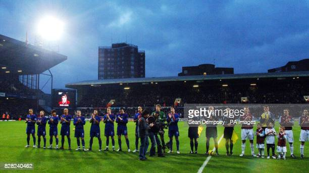 Manchester United and West Ham United players observe a minutes applause in respect for George Best who died on Friday before the Barclays...