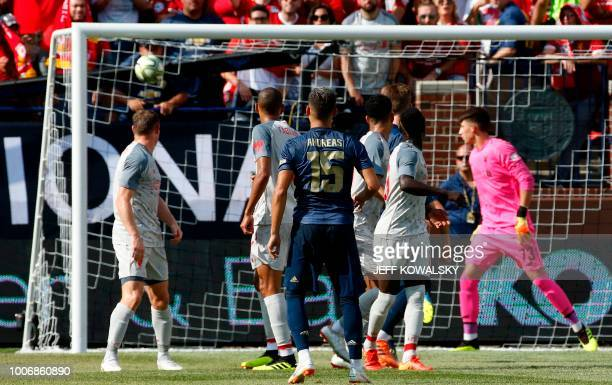 Manchester United Andreas Pereira scores against Liverpool FC during their 2018 International Champions Cup football match at Michigan Stadium on...