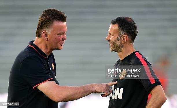 Manchester United assistant coach Ryan Giggs chats with new head coach Louis van Gaal during a training session at the Rose Bowl in Pasadena...