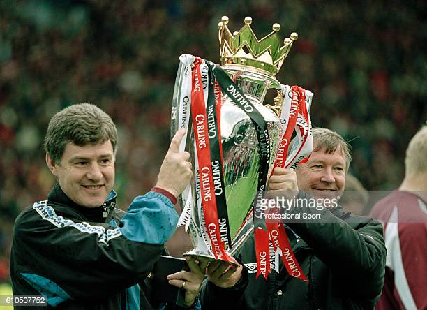 Manchester United assistant manager Brian Kidd holding the FA Carling Premier League Championship Trophy with team manager Alex Ferguson after the...
