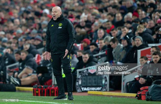 Manchester United assistant manager Mike Phelan shouts instructions to his team from the technical area during the Premier League match between...