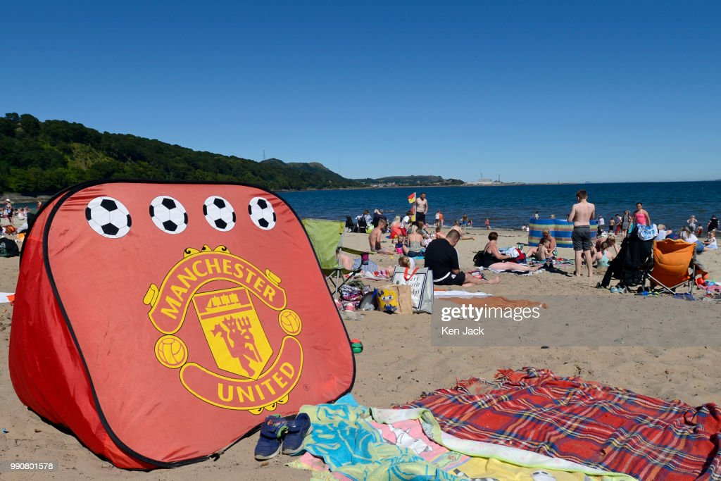 A Manchester United beach tent on Silver Sands beach as people enjoy the sun at the start of the Scottish school holidays as the heatwave continues, on July 3, 2018 in Aberdour, Scotland.