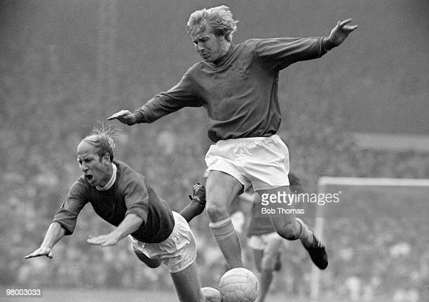 Manchester United captain Bobby Charlton falls to the ground after a challenge from Alan Birchenall of Crystal Palace during their First Division...