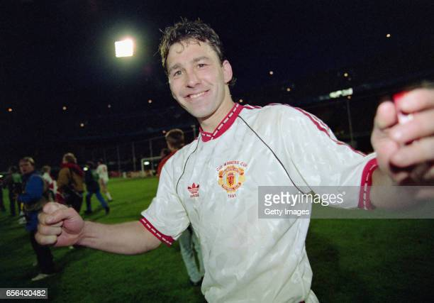Manchester United captain Bryan Robson celebrates after the 1991 UEFA European Cup Winners Cup Final between Manchester United and Barcelona on May...