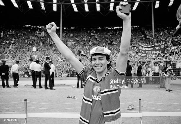 Manchester United captain Bryan Robson clutches his winner's medal during the lap of honour after his team's victory over Everton in the FA Cup Final...