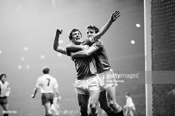 Manchester United captain Bryan Robson is congratulated by teammate Kevin Moran after scoring the first goal in their European Cup Winners Cup...