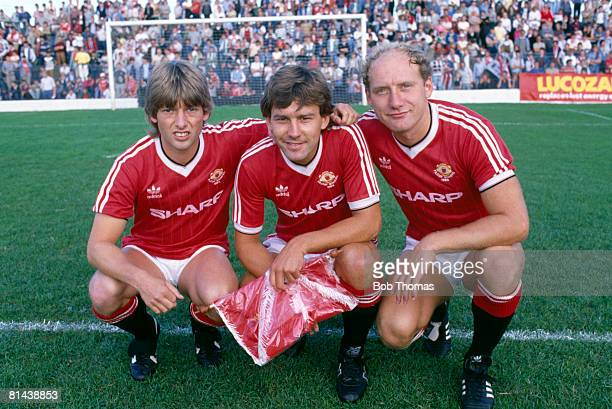 Manchester United captain Bryan Robson poses with new signings Jesper Olsen and Alan Brazil prior to their preseason match against Shamrock Rovers in...