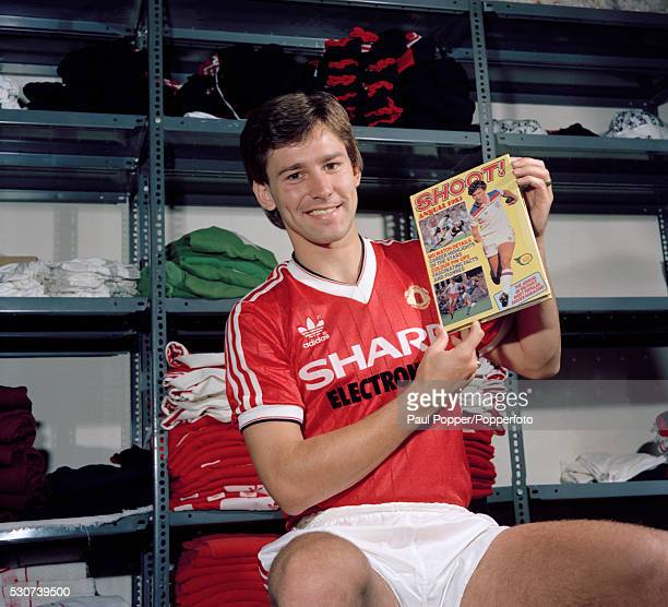 Manchester United captain Bryan Robson promoting the Shoot Magazine Annual for 1983 Robson is also pictured on the cover of the book