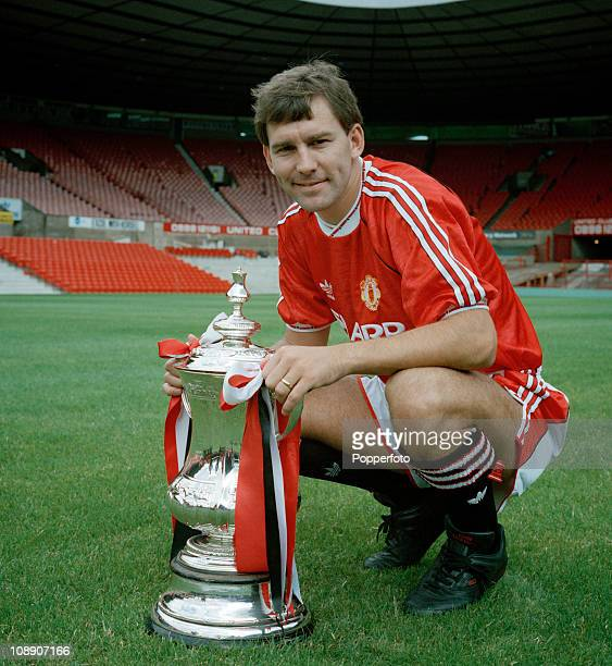 Manchester United captain Bryan Robson with the FA Cup at Old Trafford Manchester on 30th July 1990
