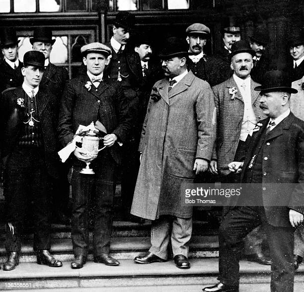 Manchester United captain Charlie Roberts holding the English FA Cup on the steps of Manchester Town Hall after their triumph over Bristol City in...