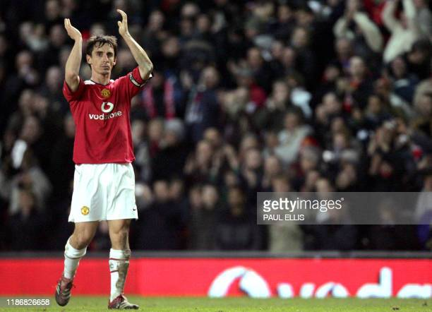 Manchester United captain Gary Neville applauds the crowd after defeating Blackburn Rovers in their English League Cup match at Old Trafford in...