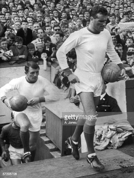 Manchester United captain Noel Cantwell leads out his team 21st August 1963