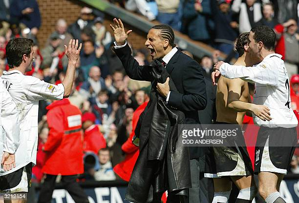 Manchester United captain Roy Keane suspended defender Rio Ferdinand Cristiano Ronaldo and John O'Shea celebrate their win over Arsenal after their...