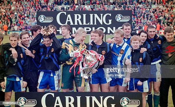 KINGDOM Manchester United captain Steve Bruce and goalkeeper Peter Schmeichel celebrate with team mates and the premiership trophy after winning the...