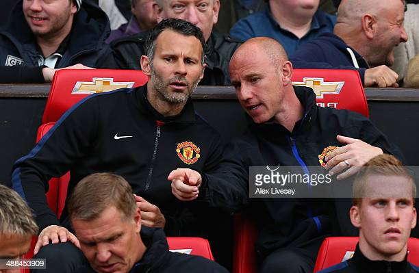 Manchester United Caretaker Manager Ryan Giggs speaks with Nicky Butt prior to the Barclays Premier League match between Manchester United and Hull...
