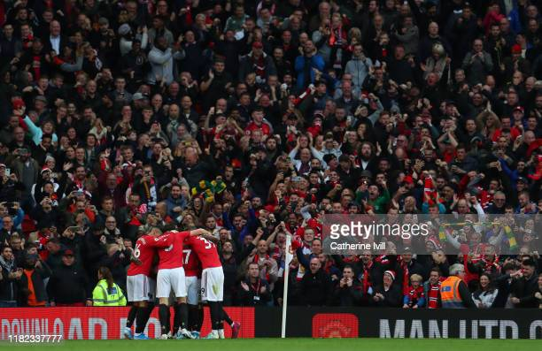 Manchester United celebrate after Marcus Rashford of Manchester United scores his side's first goal during the Premier League match between...
