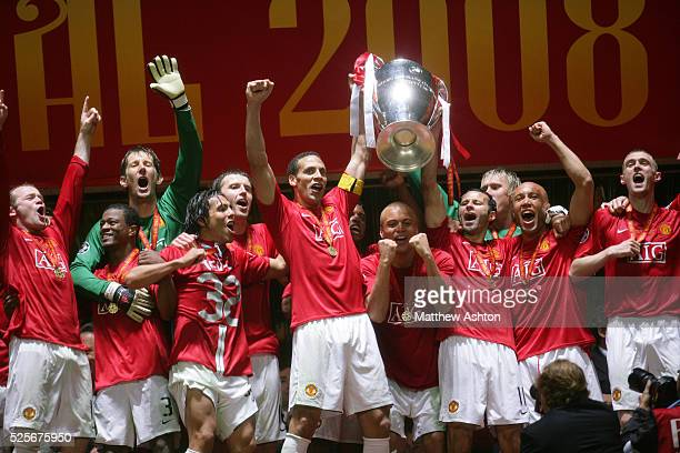 Manchester United celebrate after winning the UEFA Champions League 2008 Final with Rio Ferdinand and Ryan Giggs holding the trophy