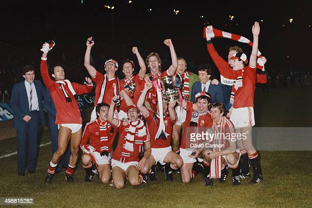 Manchester United celebrate their victory with the trophy after the FA Cup Final replay between Brighton and Hove Albion and Manchester United at...