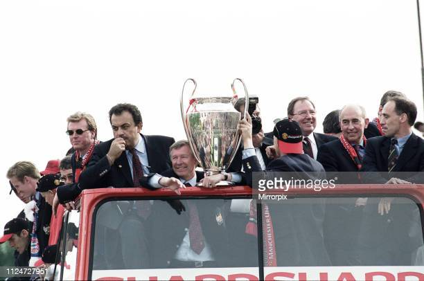 Manchester United celebrate winning the treble as the jubilant team make their way through Manchester during an open top bus parade Sir Alex Ferguson...