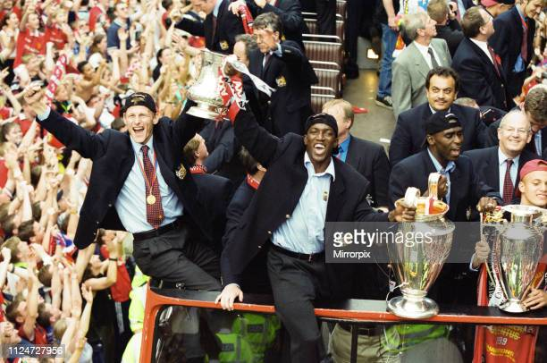 Manchester United celebrate winning the treble as the jubilant team make their way through Manchester during an open top bus parade. Teddy...