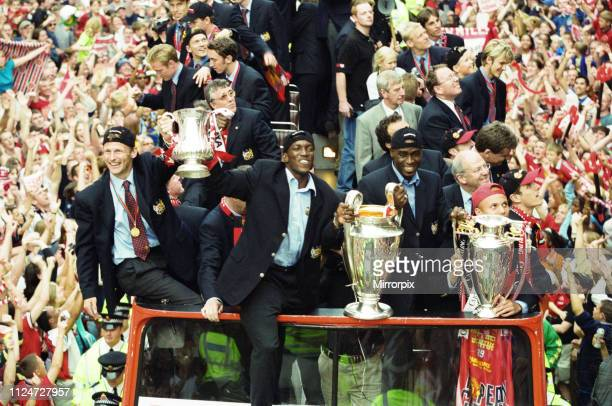 Manchester United celebrate winning the treble as the jubilant team make their way through Manchester during an open top bus parade Teddy Sheringham...
