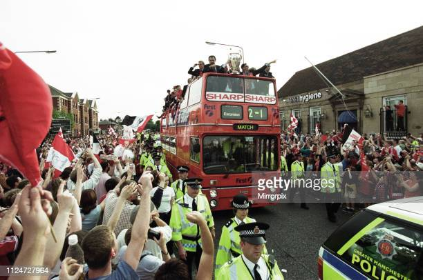 Manchester United celebrate winning the treble as the jubilant team make their way through Manchester during an open top bus parade. Sir Alex...