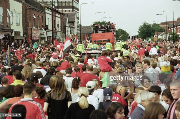Manchester United celebrate winning the treble as the jubilant team make their way through Manchester during an open top bus parade. 27th May 1999.