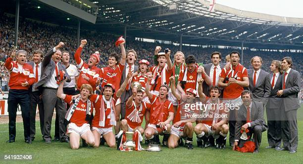 Manchester United celebrate with the trophy after the FA Cup Final between Manchester United and Everton at Wembley Stadium in London 18th May 1985...