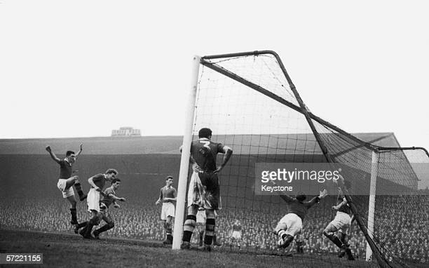 Manchester United centre forward Tommy Taylor scores his team's third goal against Chelsea at Old Trafford 1st January 1957 Chelsea goalkeeper...