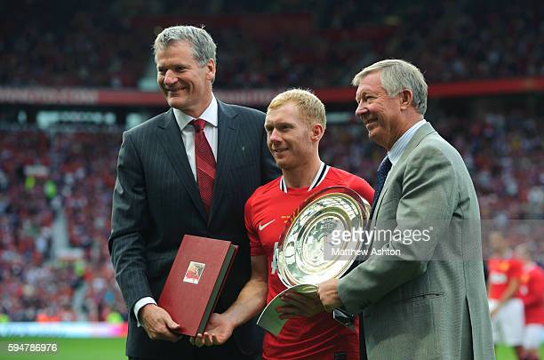 Manchester United Chief Executive David Gill Paul Scholes and Sir Alex Ferguson the head coach / manager of Manchester United