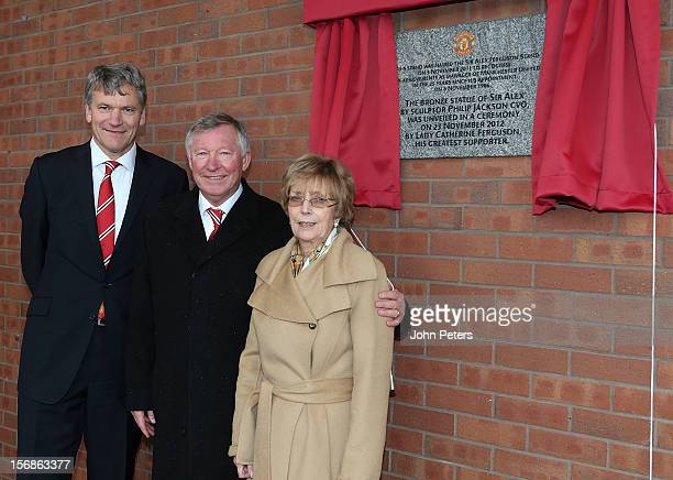 Manchester United Chief Executive David GIll Sir Alex Ferguson and Lady Cathy Ferguson pose after unveiling a plaque following the unveiling of a...