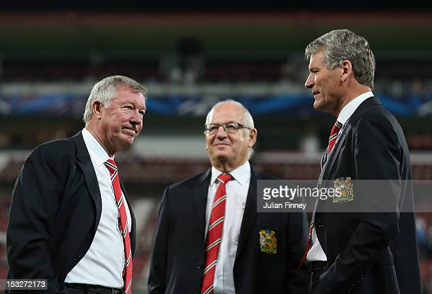 Manchester United Chief Executive David Gill talks with Sir Alex Ferguson, manager of Manchester United before the UEFA Champions League Group H...