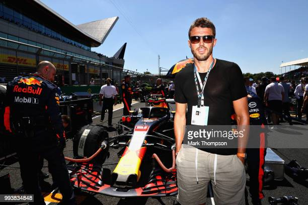 Manchester United coach and former player Michael Carrick poses for a photo with Red Bull Racing on the grid before the Formula One Grand Prix of...