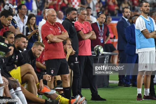 Manchester United coach Jose Mourinho and AC Milan coach Gennaro Gattuso chat while watching the penalty shoot out during their International...