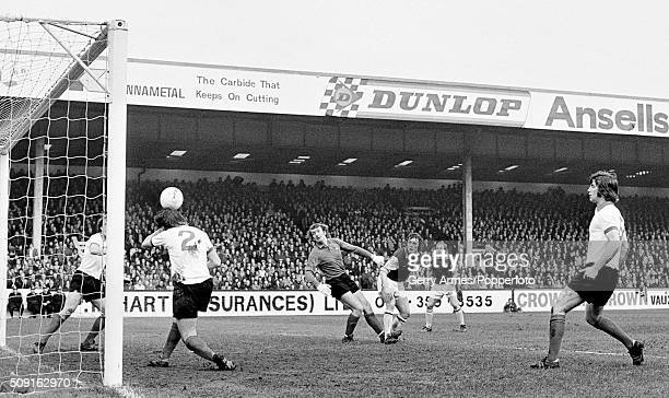 Manchester United defender Alex Forsyth heads the ball off the line with goalkeeper Alex Stepney beaten by Bobby McDonald's header for Aston Villa...