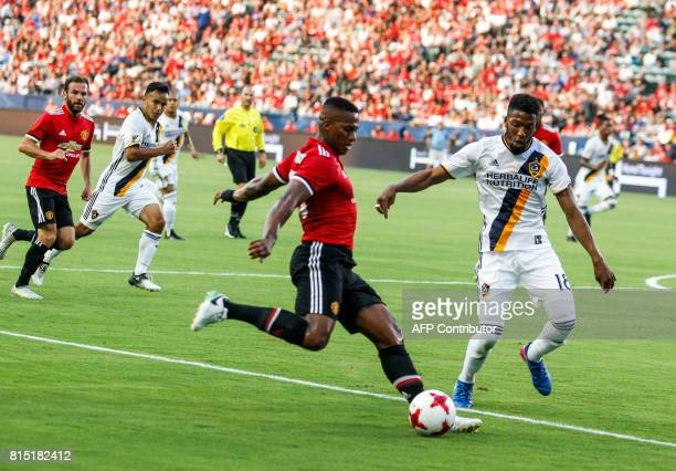 Manchester United defender Antonio Valencia kicks the ball against Los Angeles Galaxy's Bradley Diallo during the first half of a national friendly...
