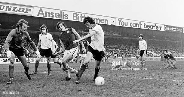 Manchester United defender Arnold Sidebottom turns the ball away from Aston Villa striker Keith Leonard with Alex Stepney and Sammy McIlroy looking...