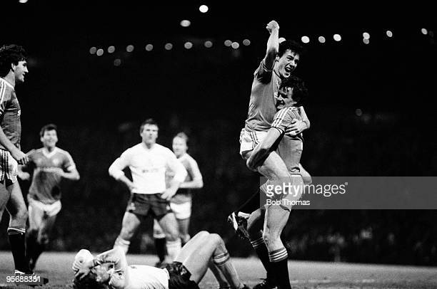 Manchester United defender Kevin Moran is congratulated by Frank Stapleton after scoring for United during their Division One football match against...
